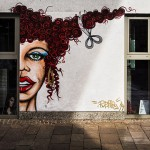 al fresco mural of curly haired lady