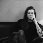 Laura Jane Grace sitting on a sofa